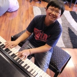boy_piano lessons aj's music factory